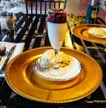 Champagne glass filled with french vanilla cream and berries