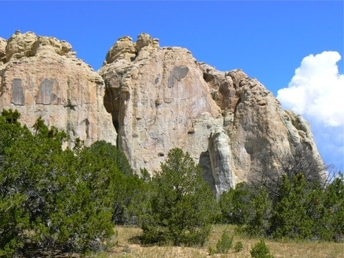 Limestone cliffs of El Morro National Monument rise from the high desert in New Mexico.