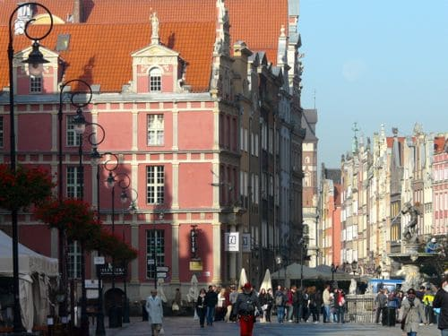 Pastel-colored buildings line the main street of Old Town Gdansk