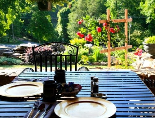 Table set for breakfast with a view of the garden at a bed and breakfast