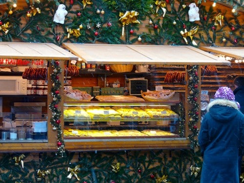 Christmas decorations surround a food stall in Strasbourg, France.