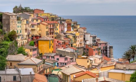 shot of colorful cliff houses overlooking the sea