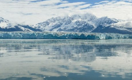 Hubbard glacier reflected in the water with mountains behind