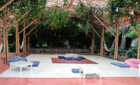 a yoga platform with mats and hammocks