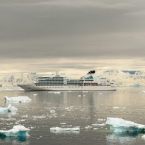 a long cruise ship in icy waters