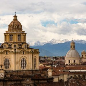 city steeples with mountains in the background