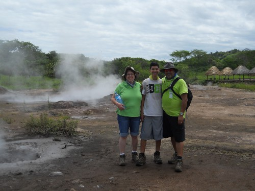 Family standing in front of boiling mud holes
