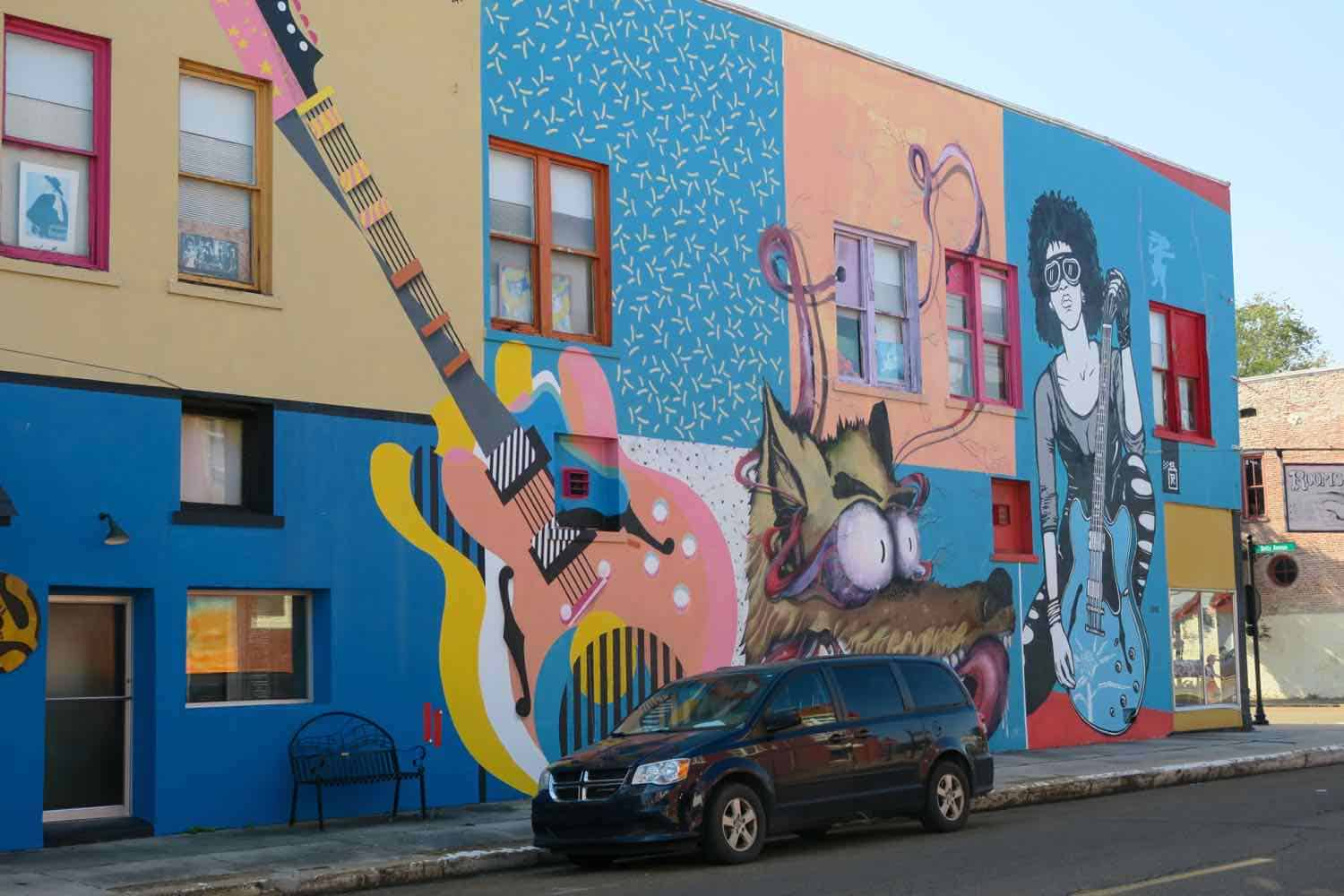 Colorful mural in a city depicting musicians.