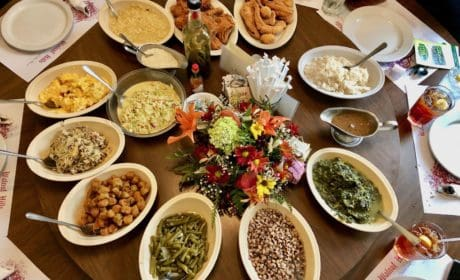 an assortment of vegetable side dishes on a dining room table lazy susan