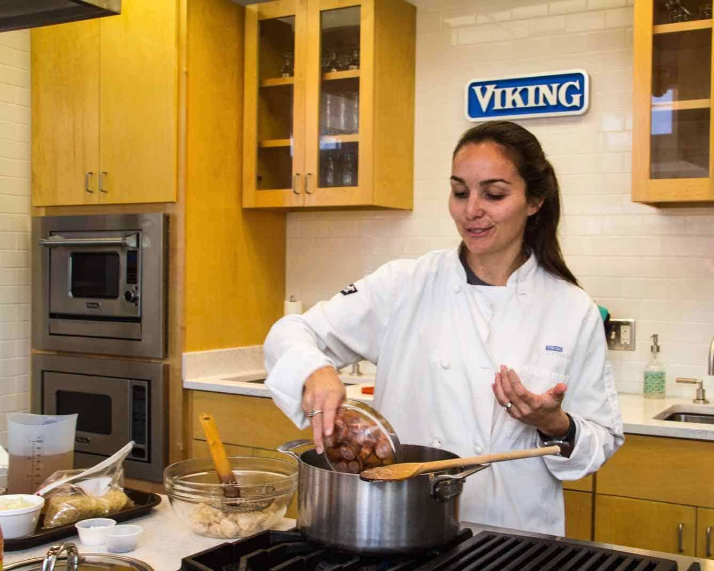 Woman teaching a Viking cooking class