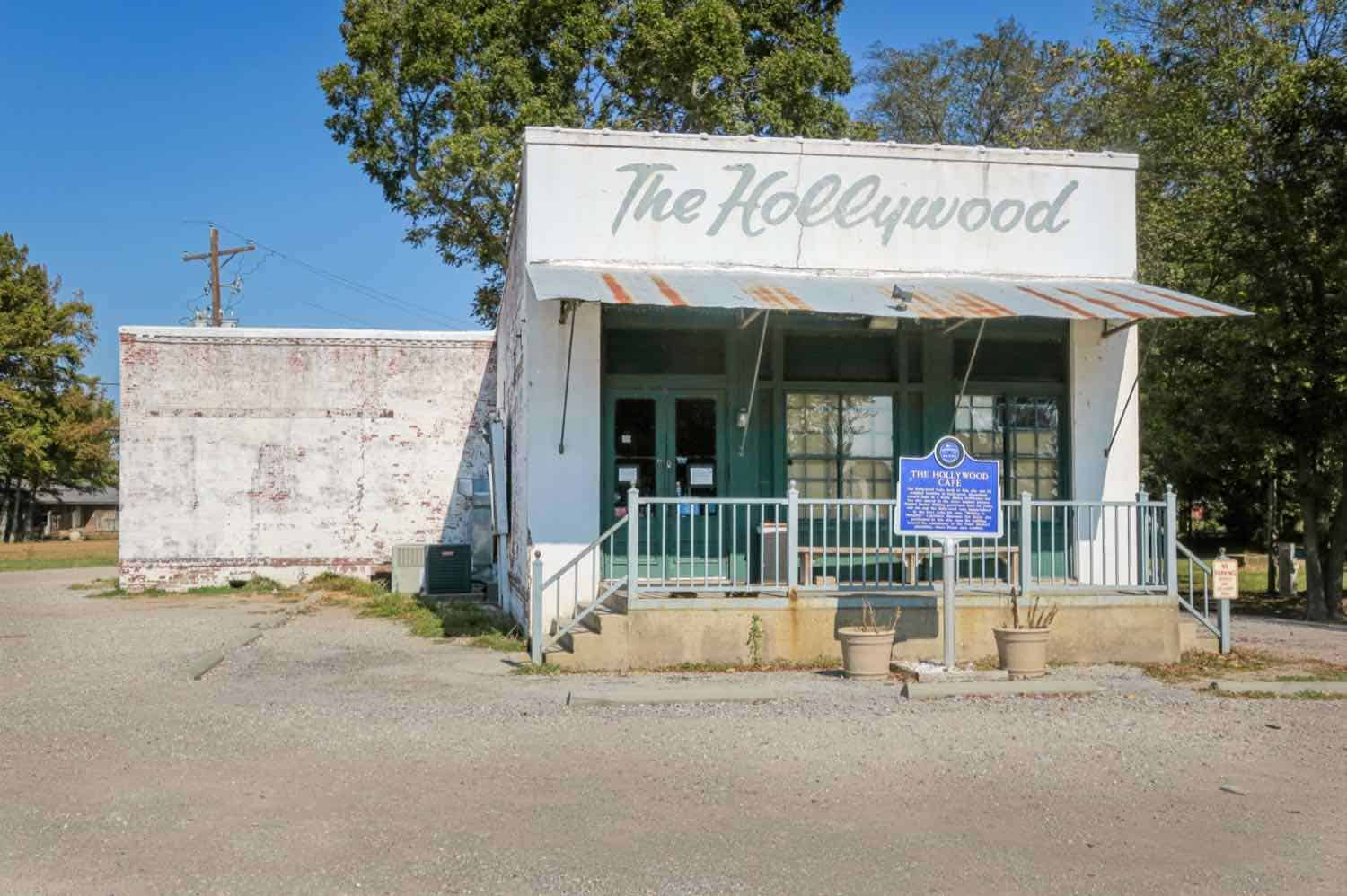 """White building with """"The Hollywood"""" written across the front."""
