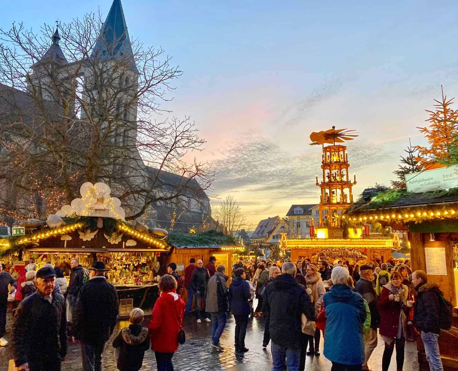 Christmas market at sunset lit up with golden-colored lights