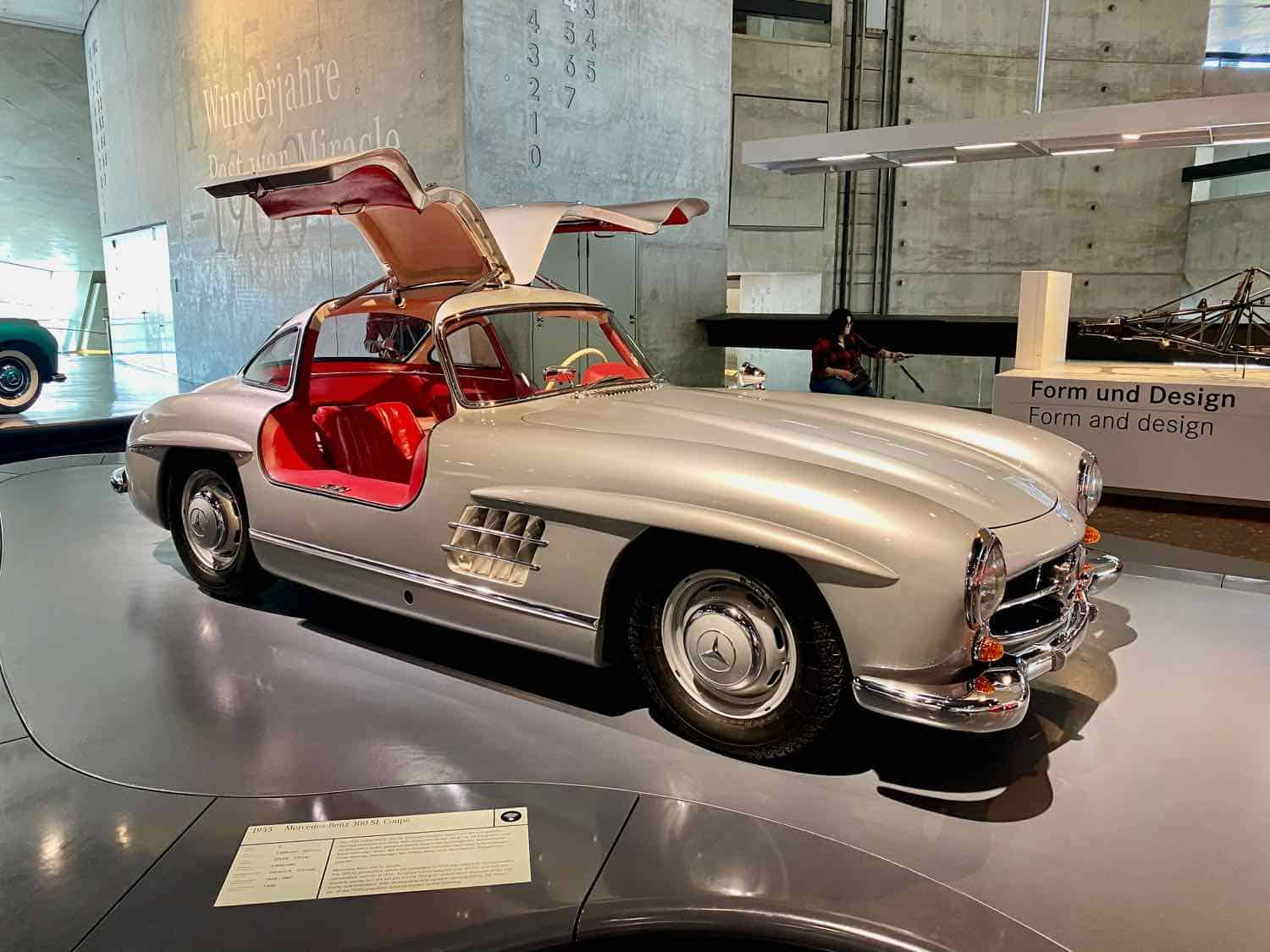 White gull-wing Mercedes-Benz with red interior