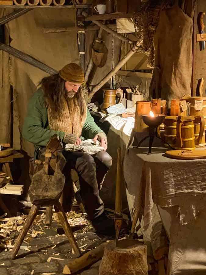 Man dressed as a medieval woodcarver