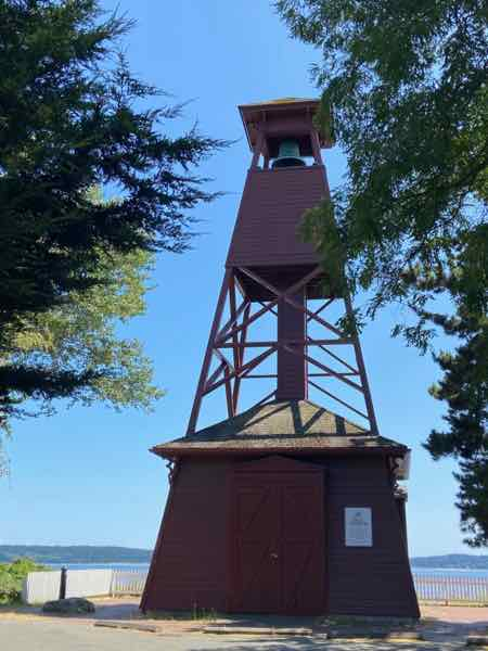wooden tower that holds a bell to warn of fires