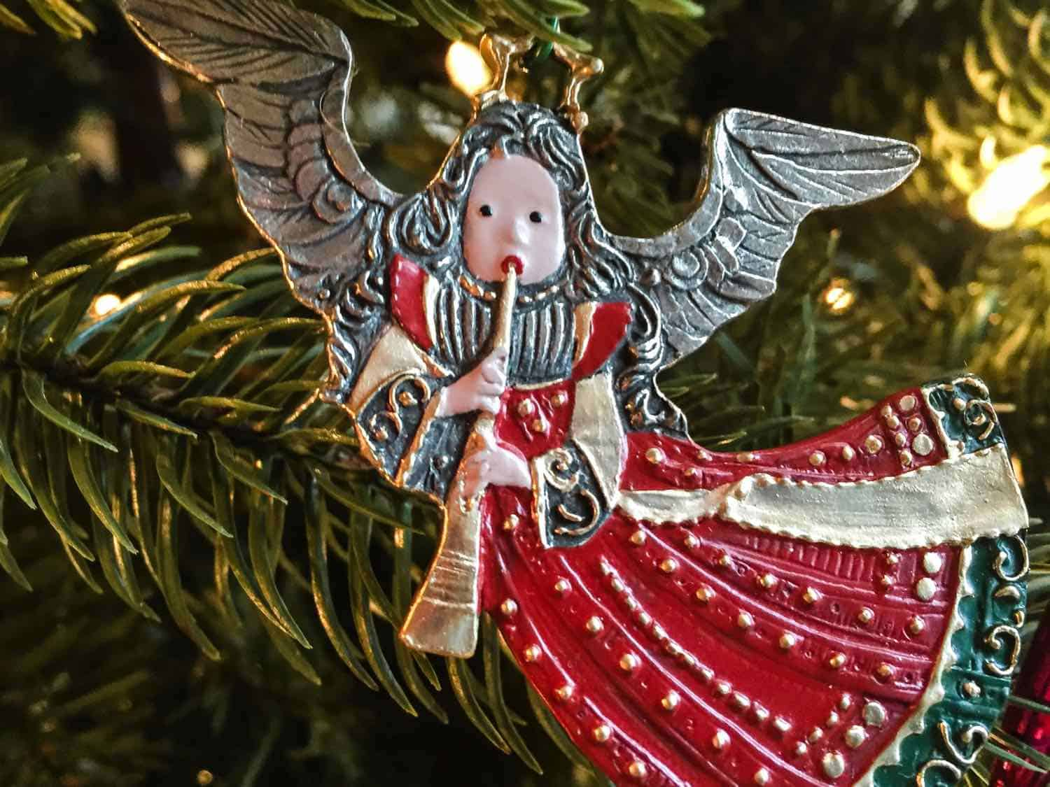 Silver and red Angel Christmas ornament made out of metal