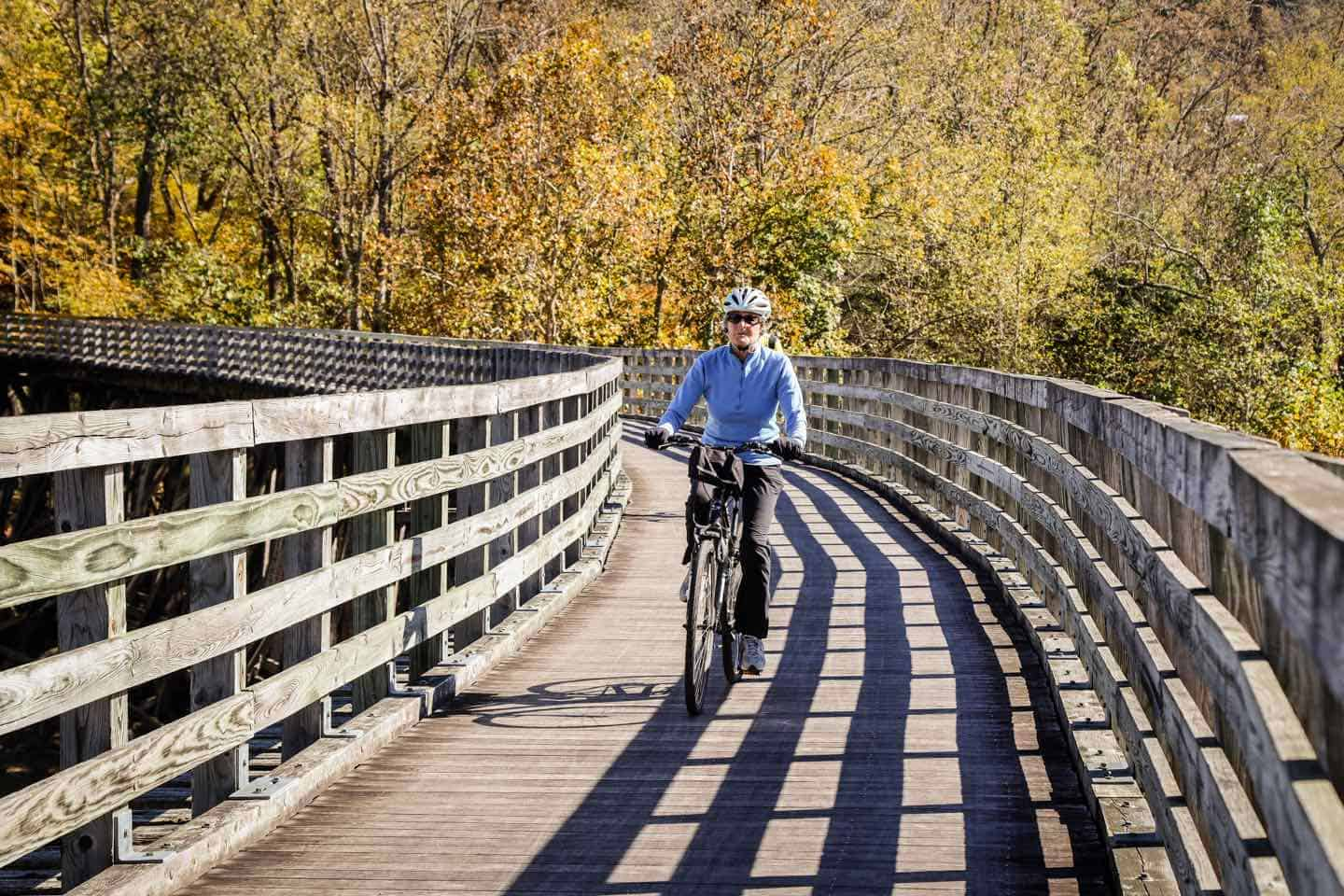 bicyclist riding on a wooden bridge of the Virginia Creeper Trail