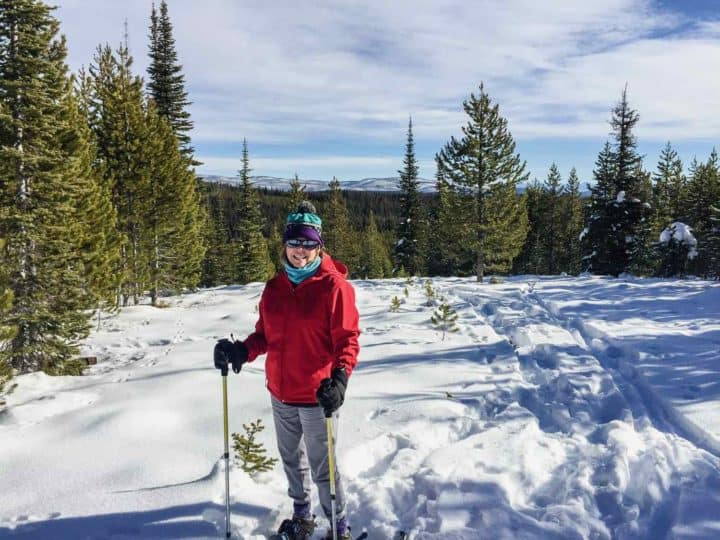 woman cross country skiing in the snow