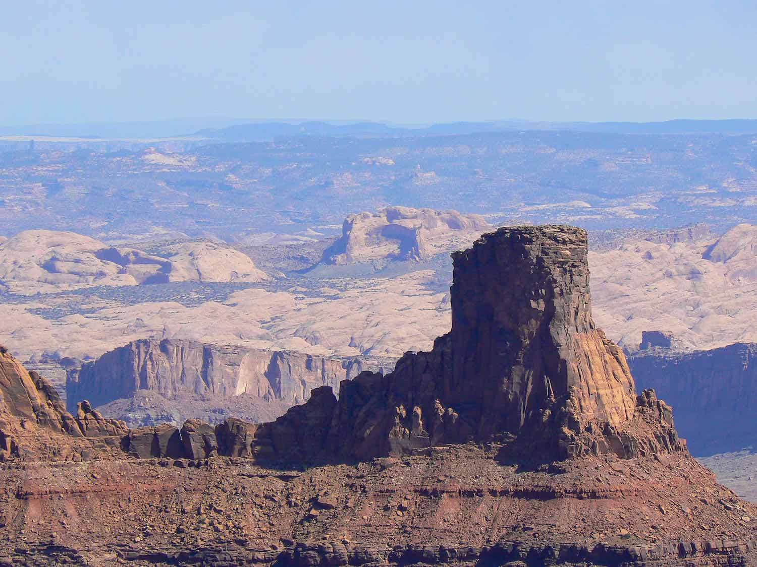 Red butte surrounded by high desert landscape