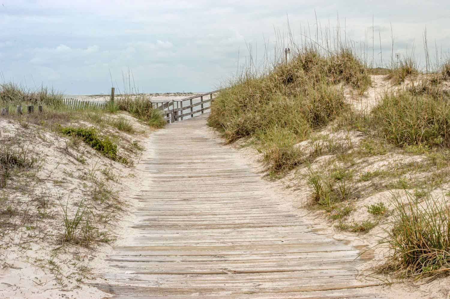 boardwalk over sand dunes leading to the beach at Dauphin Island
