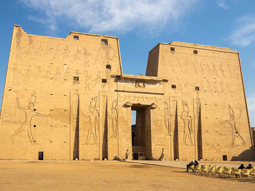 courtyard to a yellow-colored temple in Egypt