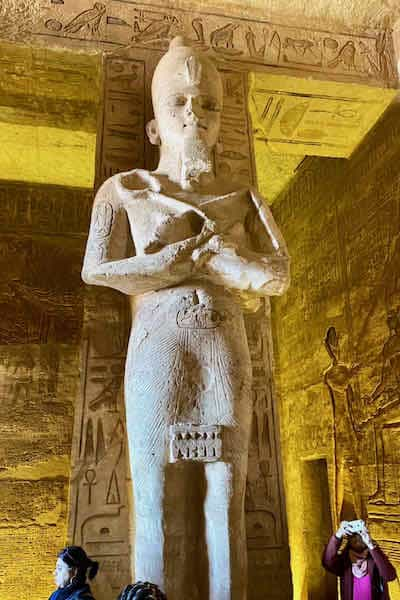 Egyptian statue standing in a great hall at Abu Simbel