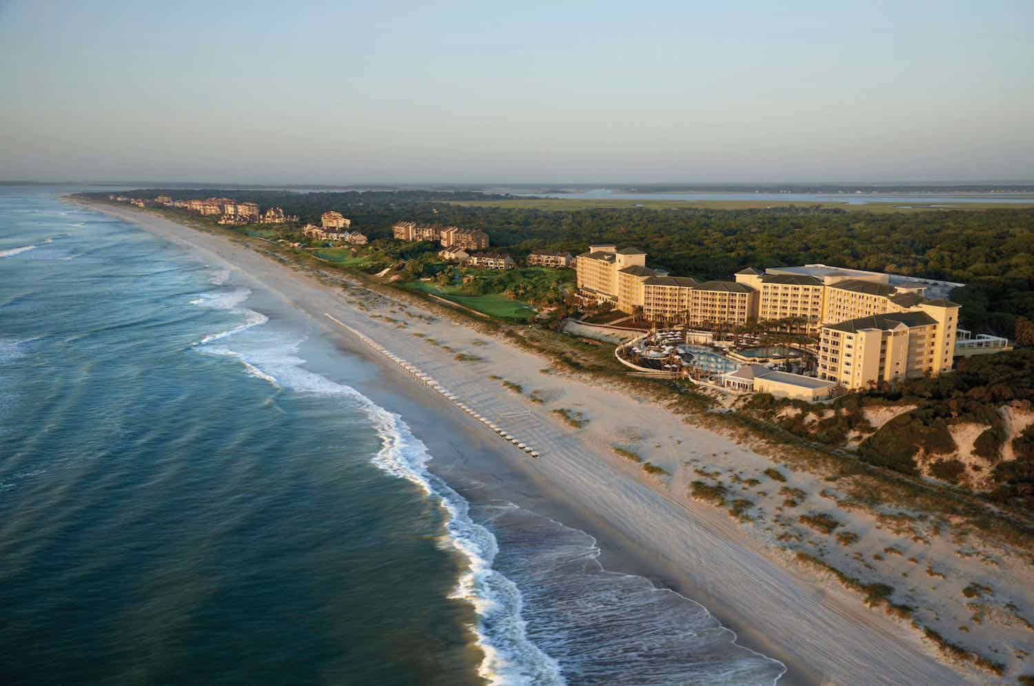 Overhead view of ocean, sand and beach condos at Amelia Island.
