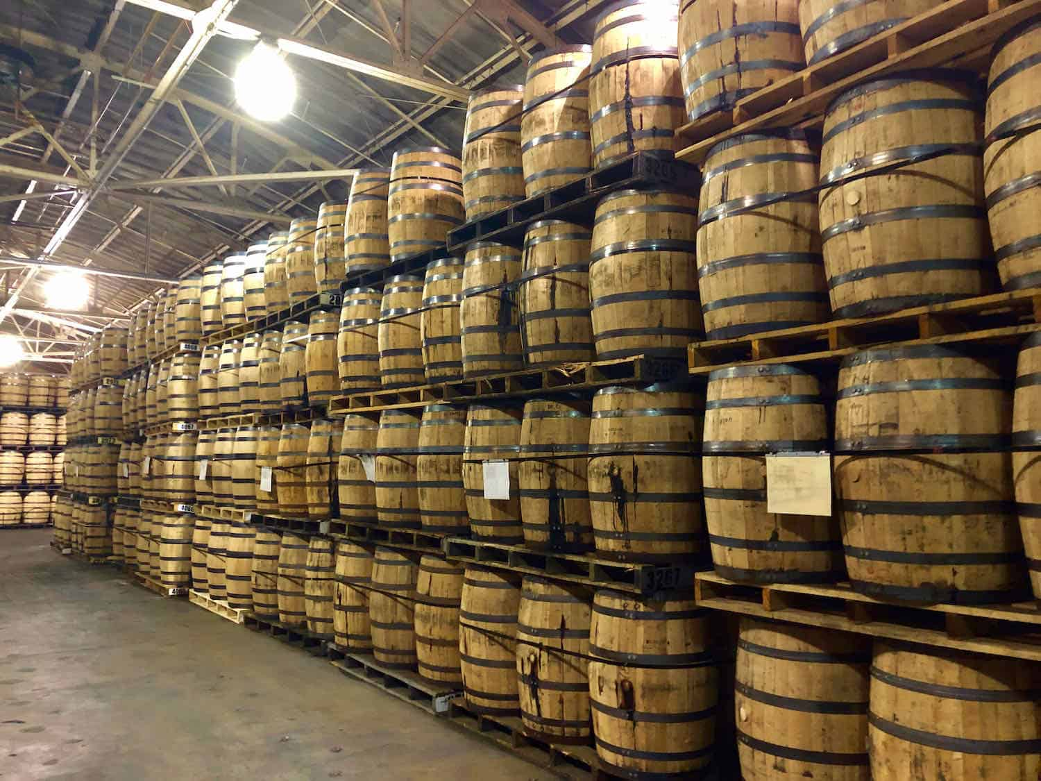 Stacks of whiskey barrels at a distillery.