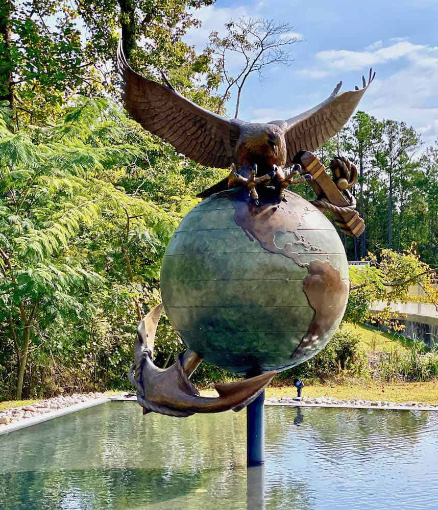 Globe statue with a bronze eagle on top and an anchor on th ebottom