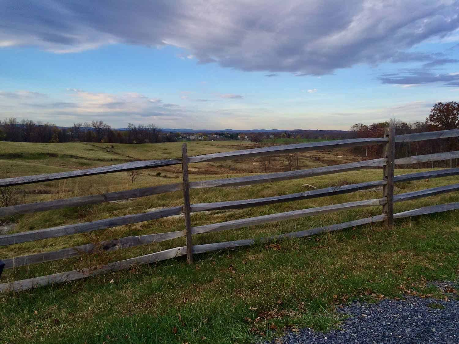 Wooden split rail fencing lookin out over the battlefield at Gettysburg.
