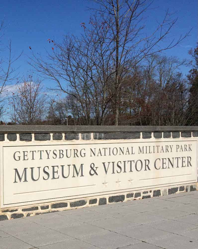 """entrance that says """"Gettysburg National Military Park Museum & Visitor Center."""
