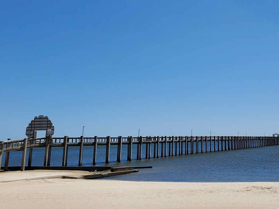 pier stretching out into the Gulf of Mexico at Pascagoula Beach, Mississippi