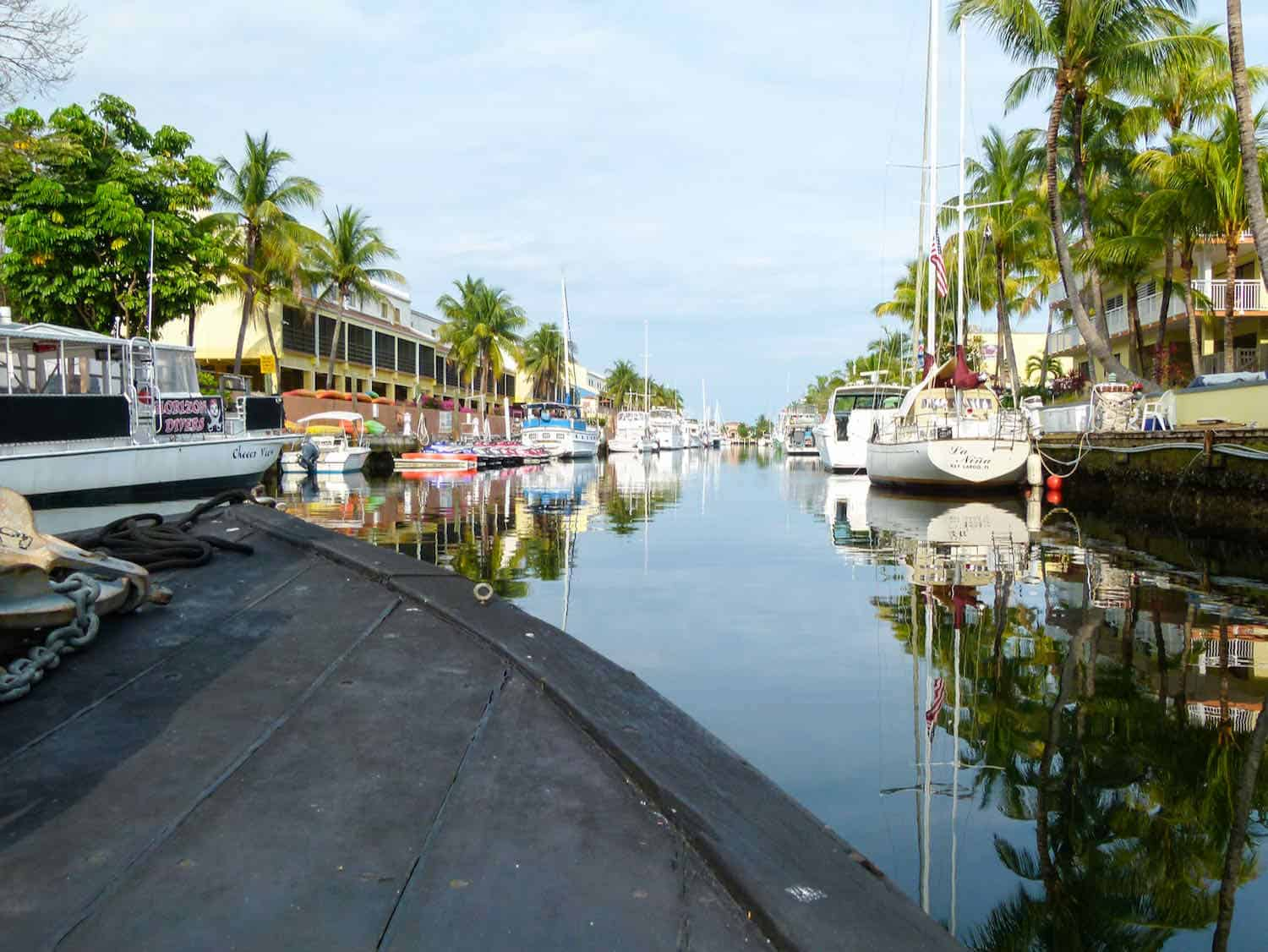 boat travels down a canal in Key Largo, Florida