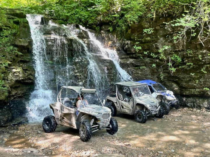 ATV's under Outlaw Waterfall in West Virginia